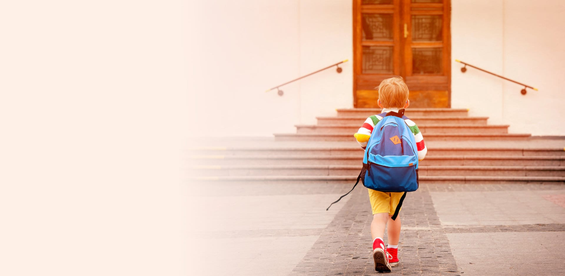 walking kid with backpack